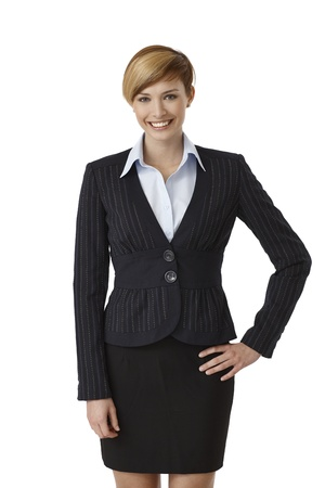 Confident young businesswoman smiling on white background