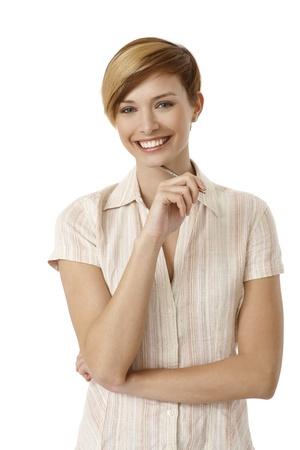 Portrait of attractive young woman holding pen, smiling. Isolated on white. photo
