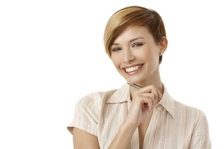 Portrait of thoughtful young woman holding pen, smiling. Isolated on white. Stock Photo - 19501858