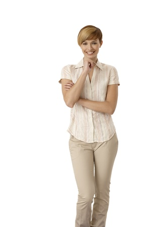 gingerish: Portrait of casual young woman holding pen, thinking. Isolated on white. Stock Photo