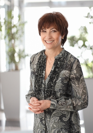 mature brunette: Portrait of happy smiling mature businesswoman, looking at camera.