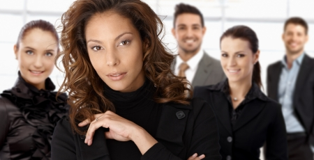 Close-up portrait of elegant young businesswoman with colleagues at background. photo