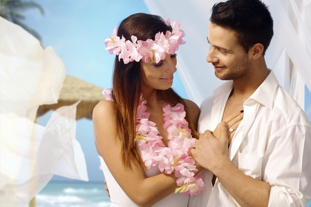 Loving couple having exotic wedding on tropical island. photo