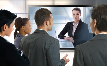 white color worker: Young businesspeople and businesswoman having video call at office. LCD display.