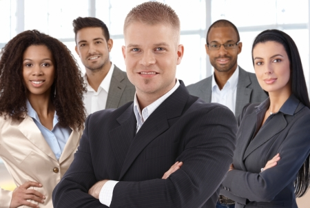 mixed race people: Team portrait of successful young businesspeople at office smiling happy.
