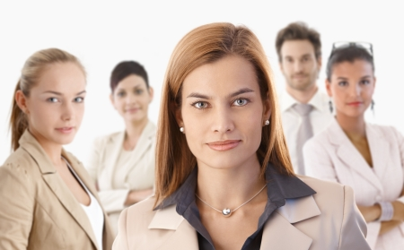 Closeup portrait of attractive young businesswoman and colleagues over white background. Stock Photo - 22072923