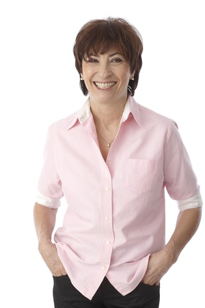 one senior: Portrait of happy smiling mature woman standing with hands in pocket. Stock Photo