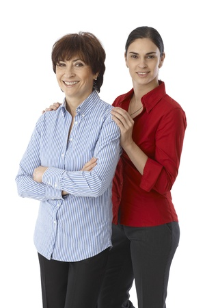 Mother and daughter smiling happy, looking at camera. Daughter touching senior mother's shoulders. Stock Photo - 22073196