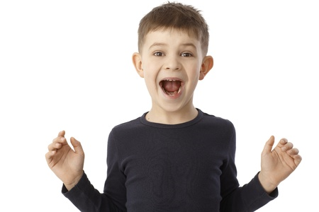 outspreading: LIttle boy shouting happy, looking surprised with open arms. Stock Photo
