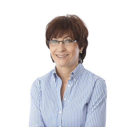 Portrait of mature woman smiling, wearing glasses, looking at camera.