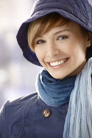 Closeup portrait of happy young woman early spring clothing photo