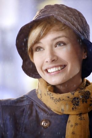gingerish: Closeup portrait of attractive young woman in rain, smiling. Stock Photo