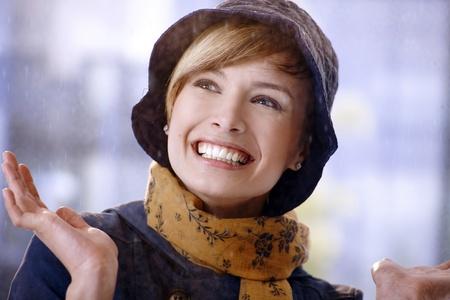gingerish: Closeup portrait of happy young woman enjoying rain, smiling.