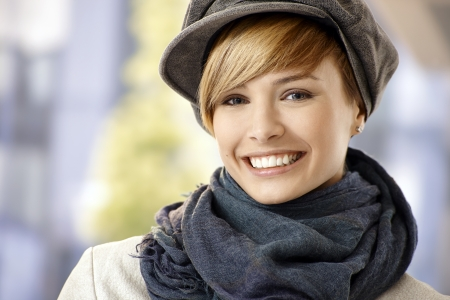 gingerish: Attractive young woman in winter sunshine, smiling.