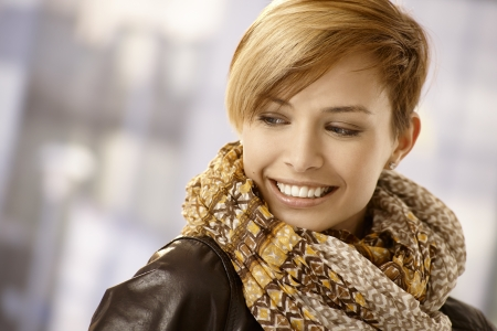 gingerish: Closeup portrait of young woman with scarf, looking back