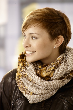 gingerish: Profile portrait of Young woman wearing scarf and leather jacket