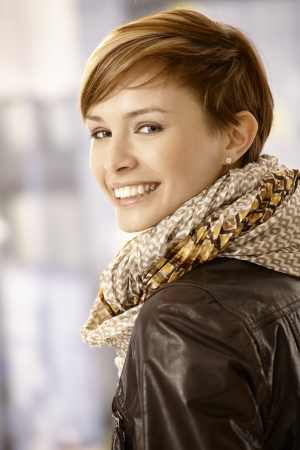 gingerish: Happy young woman looking back over her shoulder and smiling