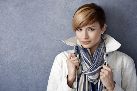 20s  closeup: Closeup portrait of beautiful young woman wearing jacket and scarf