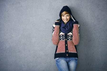 22070707: Attractive young woman wearing warm nordic sweater and hat, smiling Stock Photo