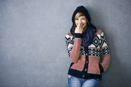 Portrait of happy young woman in scandinavian sweater, laughing