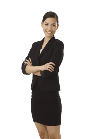 Happy young Asian woman standing arms crossed, smiling in black costume. photo