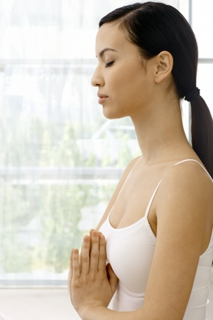 Profile of young attractive woman practicing yoga, relaxing eyes closed. photo