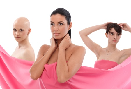 cancer woman: Young women wrapped into pink textile.   This is a free image, part of a charity project. Models and the staff worked for free to support breast cancer awereness campaigns worldwide. Stock Photo