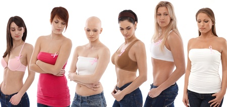 Young women in underwear wearing pink breast cancer awereness ribbon.   This is a free image, part of a charity project. Models and the staff worked for free to support breast cancer awereness campaigns worldwide.