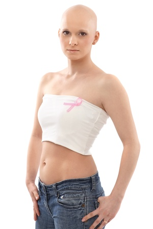 Young woman in underwear wearing pink breast cancer awereness ribbon.   This is a free image, part of a charity project. Models and the staff worked for free to support breast cancer awereness campaigns worldwide.
