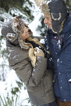 Happy loving couple smiling, embracing at wintertime. photo