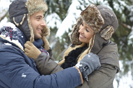 be kissed: Outdoor photo of loving couple embracing at wintertime, smiling happy.