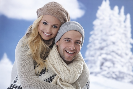 Closeup portrait of happy loving couple embracing at wintertime. Imagens