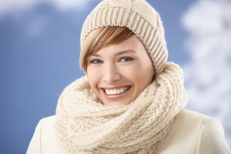 Portrait of attractive young woman in winter clothes, smiling