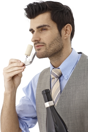 bristly: Wine-expert smelling cork after opening bottle of wine.
