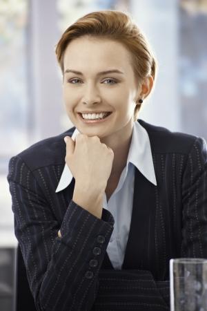 gingerish: Closeup portrait of elegant happy businesswoman in office.