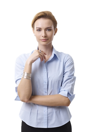 gingerish: Standing portrait of attractive young businesswoman looking at camera. Stock Photo