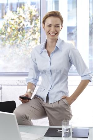 woman short hair: Portrait of happy smiling young businesswoman in office.