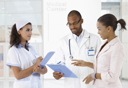 image consultant: Doctor nurse and patient discussing case at medical center.
