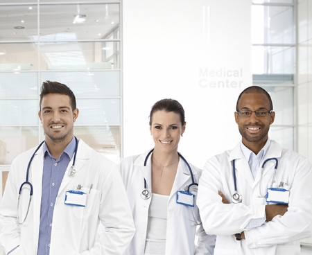 image consultant: Team photo of happy young confident doctors at medical center.