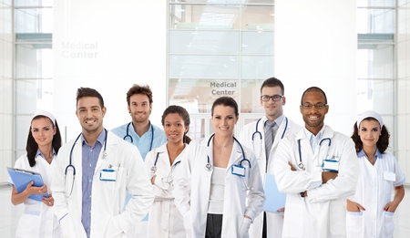 Portrait of young doctors and nurses at medical center, all smiling. photo
