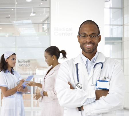 Portrait of young afro-american doctor at medical center. Stock Photo - 22854300