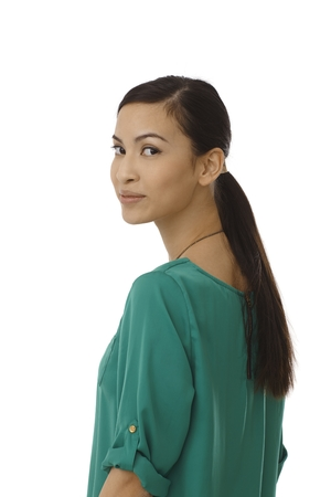 Pretty young Asian girl looking back over shoulder. Portrait. photo