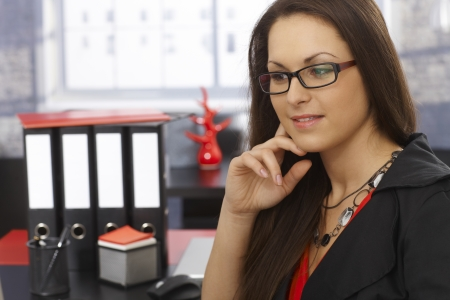 fantasize: Portrait of young businesswoman thinking at workplace. Stock Photo