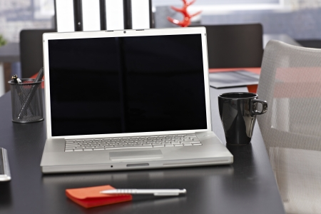 desk tidy: Office desk with laptop and folders. Stock Photo