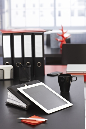 desk tidy: Workplace with tablet, personal organizer and mug. Stock Photo