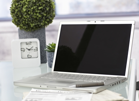 Closeup photo of laptop computer with open top. Blank screen. photo