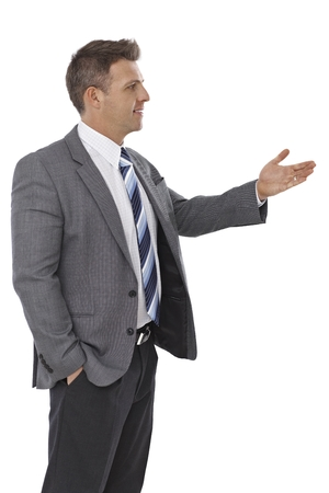 Young businessman looking left, gesturing, talking. photo