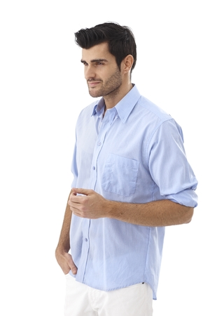 Young man in casual clothes turning right, looking away. photo