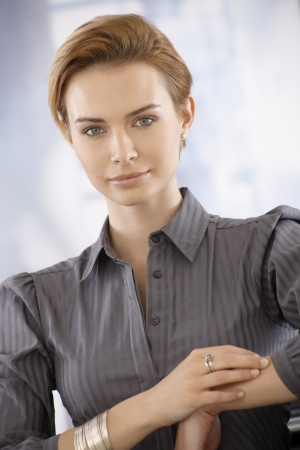 gingerish: Closeup portrait of attractive young businesswoman, looking at camera.