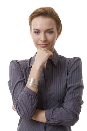 gingerish: Portrait of young smiling businesswoman standing with arms crossed.